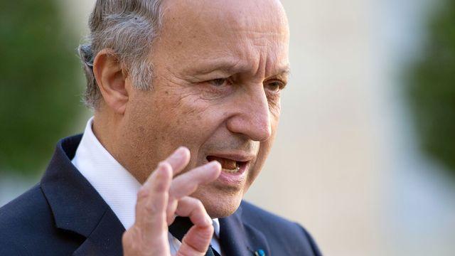 """""""La Suisse ne représente pas une puissance économique considérable"""", rappelle Laurent Fabius. [AFP]"""