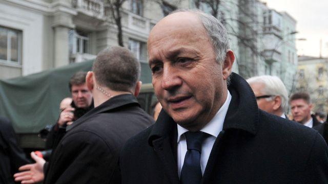 Les trois ministres de l'UE, dont Laurent Fabius, vont rester plus longtemps que prévu à Kiev. [Genya Savilov - AFP]