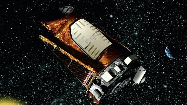"""Une vision d'artiste du télescope spatial Kepler, surnommé """"le chasseur de planètes"""" [Keystone]"""