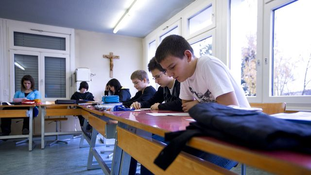 L'UDC se pose en défenseur des valeurs chrétiennes de l'Etat. [Gaëtan Bally - Keystone]