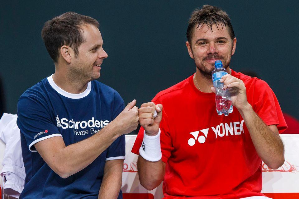 Il y a de l'ambiance à l'entraînement entre Severin Lüthi et Stanislas Wawrinka. [Salvatore Di Nolfi - Keystone]