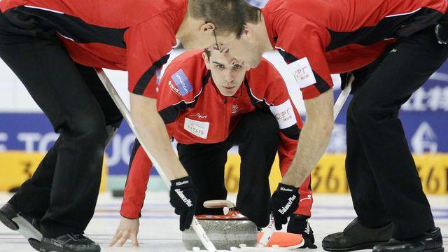 De Cruz (au centre) emmènera-t-il les Suisses en playoff? [Alexander F. Yuan - Keystone]