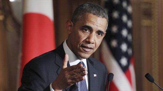 Barack Obama hausse le ton face à la Russie de Vladimir Poutine. [AP Photo/Junko Kimura-Matsumoto - Keystone]