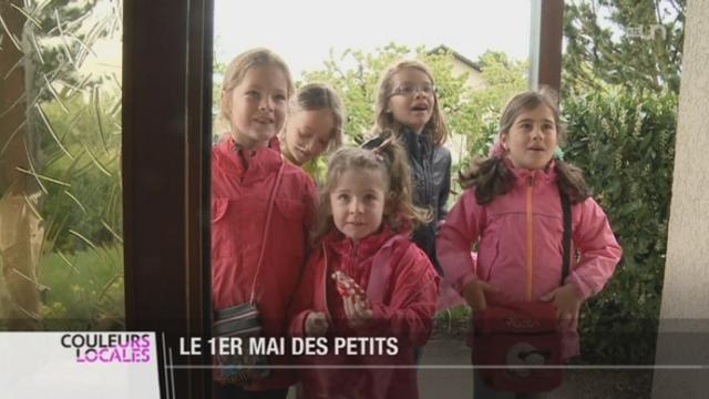 FR: les enfants célèbrent le 1er Mai en chantant [RTS]