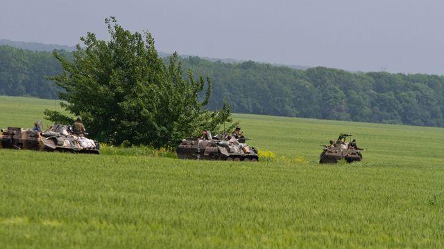 L'OTAN a confirmé le retrait de deux tiers des troupes russes, massées le long de la frontière avec l'Ukraine. [Sergii Kharchenko - NurPhoto - AFP]