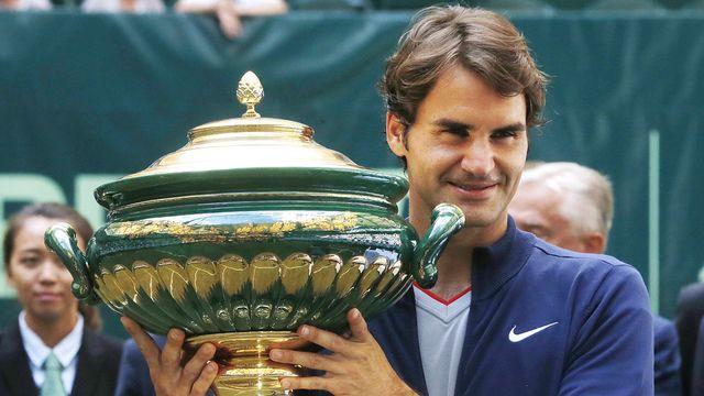 Federer a retrouvé le sourire sur le gazon de Halle. [Michael Probst - Keystone]