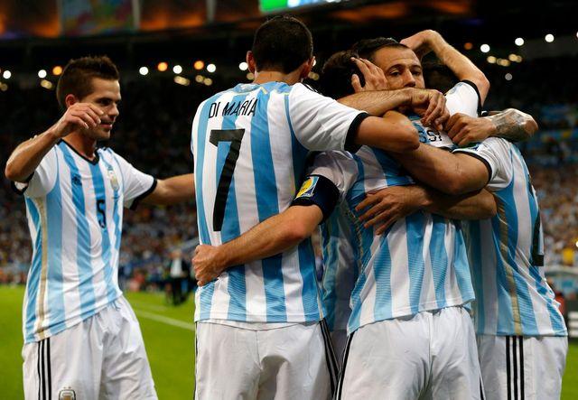 Les Argentins jubilent après le 2-0 signé par l'incontournable Lionel Messi. [Abedin Taherkenareh - Keystone]