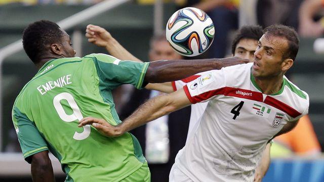 Nigérians et Iraniens se son neutralisés sur la pelouse de Curitiba. [Fernando Vergara - Keystone]