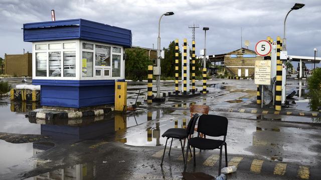 Les combats se poursuivent notamment autour du poste-frontière d'Izvarino. [Valeriy Melnikov/RIA Novosti - AFP]