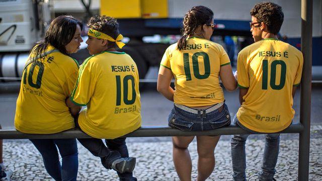 Au Brésil, religion et football font bon ménage... [Yasuyoshi Chiba - AFP]