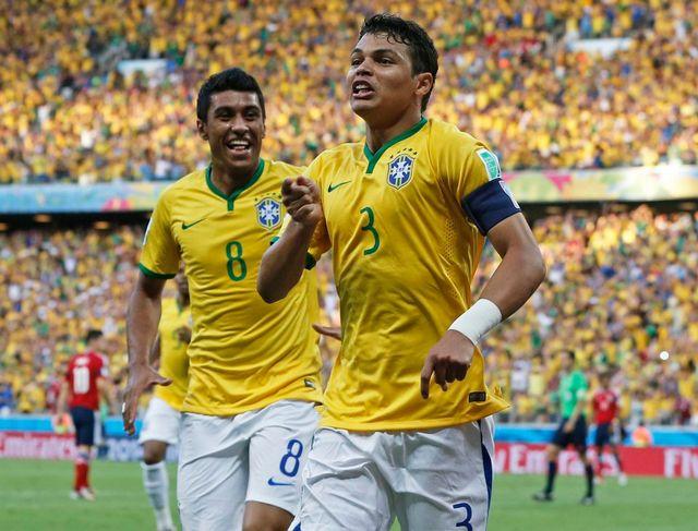 La rage de Thiago Silva qui vient d'ouvrir le score pour la Seleçao. [TOLGA BOZOGLU - Keystone]