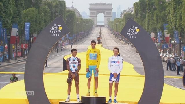 Vincenzo Nibali (ITA-1er), Jean-Christophe Péraud (FRA-2e) et Thibaut Pinot (FRA-3e) sur le podium du 101e Tour de France [RTS]