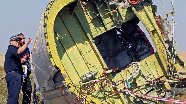 Des inspecteurs néerlandais et australiens dépêchés le 1er août sur le site du crash du MH17 ont quitté les lieux en raison de tirs d'artillerie. [Igor Kovalenko - EPA]