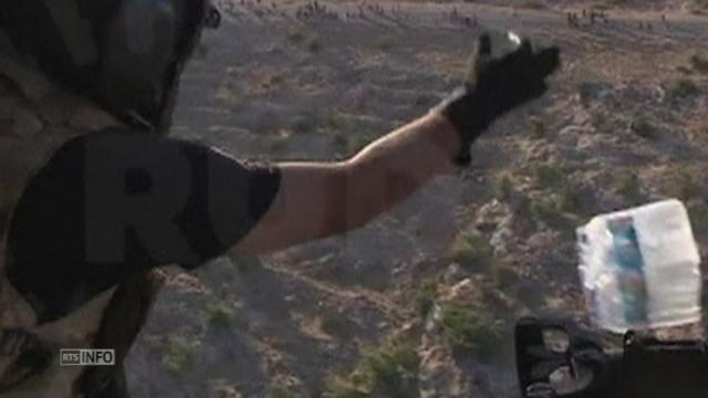 Largage de vivres dans les montagnes de Sinjar (Irak) [RTS]
