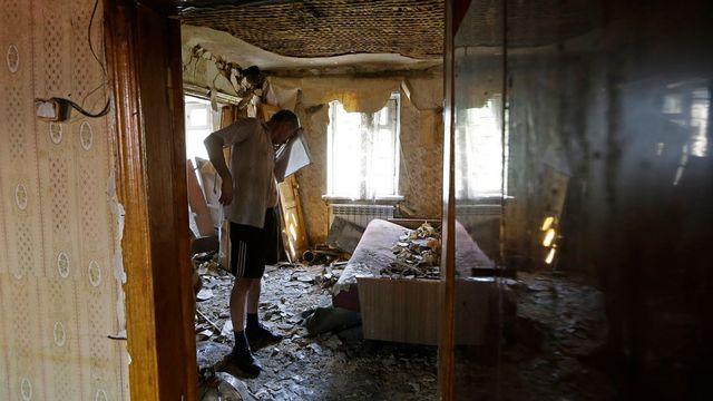 Donetsk est sous le feu des bombes. [AP Photo/Sergei Grits - Keystone]
