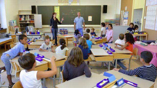 Les enseignants romands se montrent pessimistes en vue de la rentrée 2014. [Christian Brun - Keystone]
