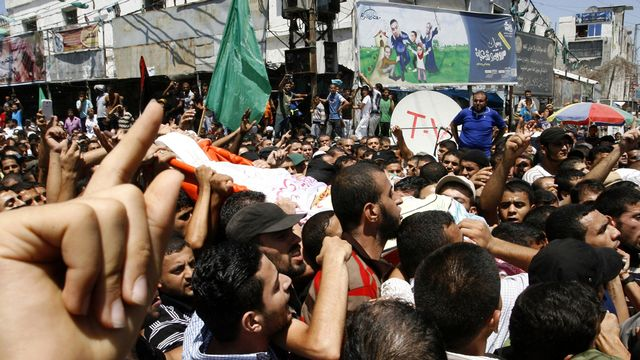 Les trois chefs militaires du Hamas ont été enterrés jeudi. [Rahim Khatib/Anadolu Agency - AFP]