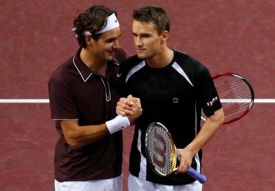 Federer et Chiudinelli sont amis dans la vie. [Reuters]