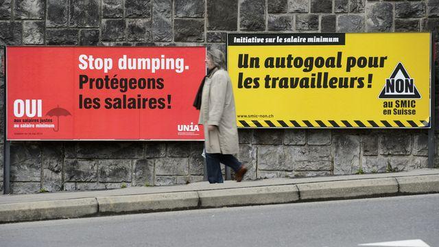 La population suisse a refusé l'instauration d'un salaire minimum au niveau fédéral lors des votations du 18 mai. [Laurent Gillieron - Keystone]