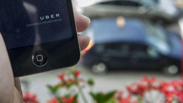 Les taxis Uber se commandent via l'application de la compagnie. Christian Beutler Keystone [Christian Beutler - Keystone]