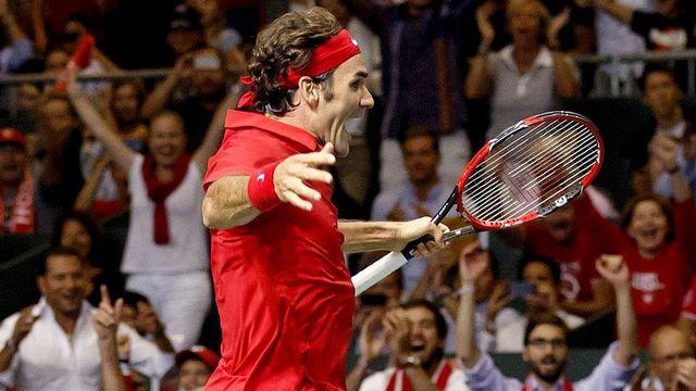 Federer a parfaitement tenu son rang avec deux succès en simple face aux Italiens. [Salvatore Di Nolfi]