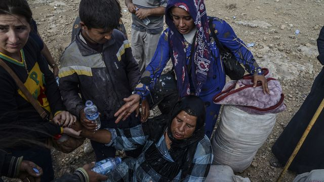 Les Kurdes ont fui la Syrie par dizaines de milliers pour se rendre en Turquie. [Ilyas Akengin - AFP]