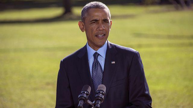 """Barack Obama a salué la """"force de la coalition"""" contre les djihadistes de l'EI. [Jim Watson - AFP]"""
