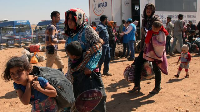 Des dizaines de milliers de Kurdes syriens sont venus se réfugier en Turquie. [Burhan Ozbilici - AP Photo - Keystone]