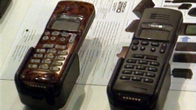 """Téléphoner de partout: le """"Natel"""" change les habitudes."""