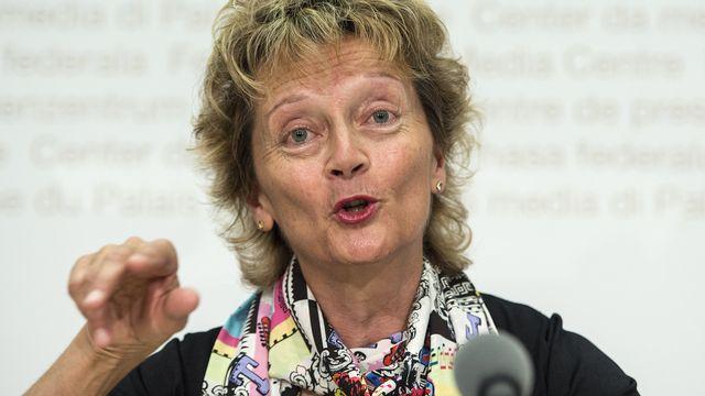 La conseillère fédérale Eveline Widmer-Schlumpf, lors d'une conférence de presse sur la campagne contre l'initiative sur la TVA, le 11 août 2014. [Peter Schneider - Keystone]