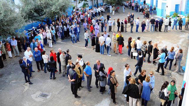 Les Tunisiens se sont déplacés en masse pour les législatives [AP Photo/Hassene Dridi - Keystone]