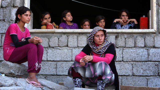 Des centaines de femmes sont enlevées, violées puis vendues comme esclaves sexuelles par les djihadistes de l'Etat islamique. [Safin Hamed - AFP]
