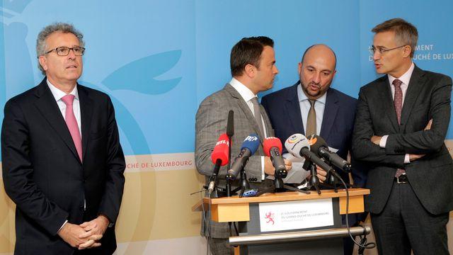 Les ministres luxembourgeois étaient réunis pour un point de presse jeudi après les révélations sur les accords fiscaux. [AP Photo/Charles Caratini - Keystone]