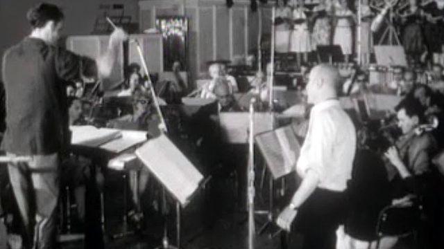 En 1964, Jack Rollan dirige une cantate pour l'Expo nationale.