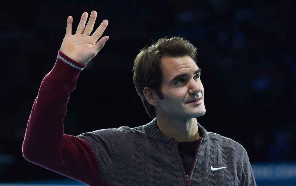 Roger Federer espère que ses douleurs au dos disparaîtront bientôt. [Keystone]