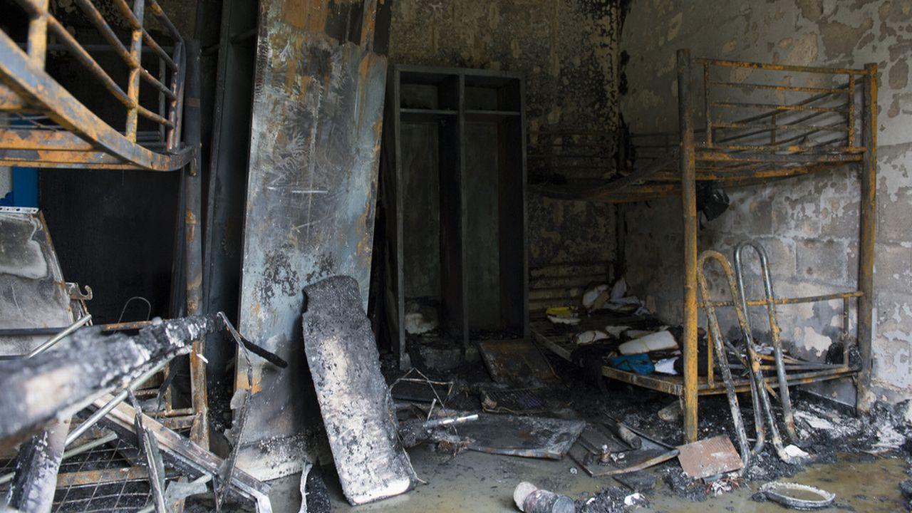 Les dégâts dans un foyer pour requérants à Vernier. [Anthony Anex - Keystone]