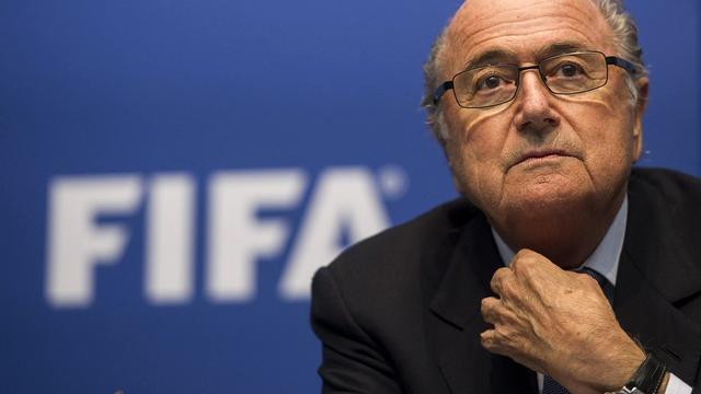 """Sepp Blatter dirait """"oui à un nouveau mandat"""" si les associations membres lui demandent d'être candidat à l'élection en 2015. [Ennio Leanza - Keystone]"""