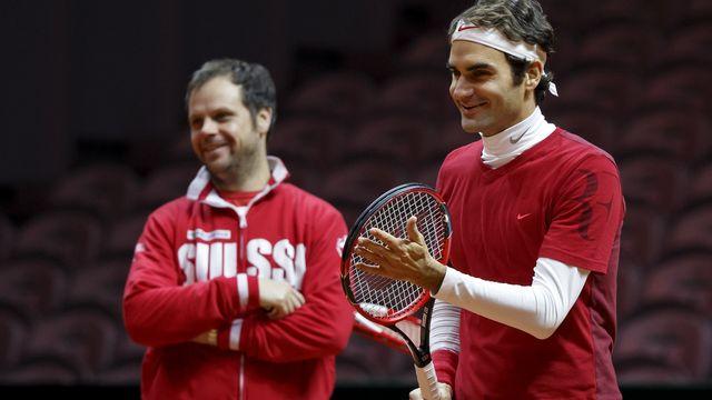 Federer a réussi a redonner le sourire à son capitaine Lüthi. [Salvatore Di Nolfi - Keystone]