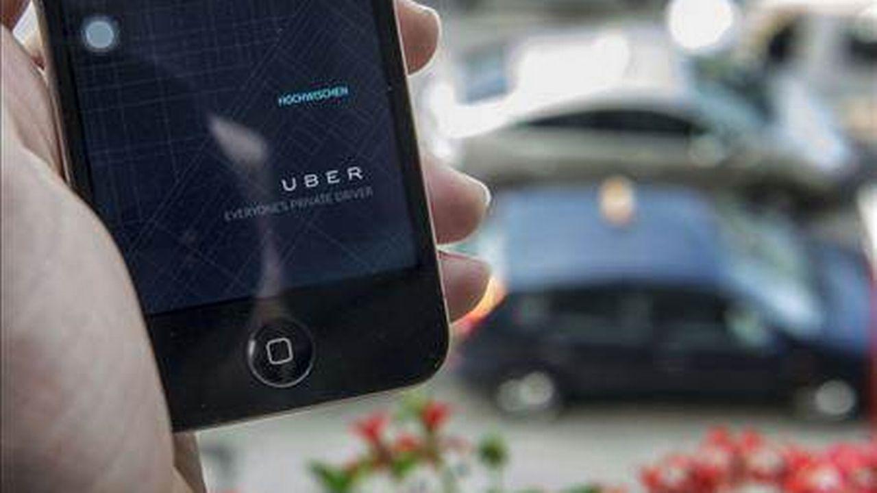 Les taxis Uber se commandent via l'application de la compagnie. [Keystone]