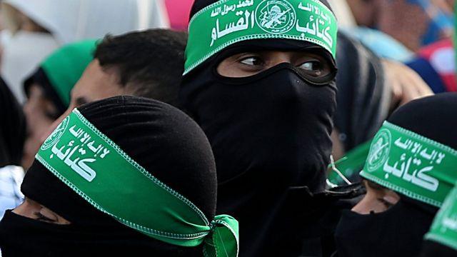 Des membres de la branche armée du Hamas. [EPA/Mohammed Saber - Keystone]