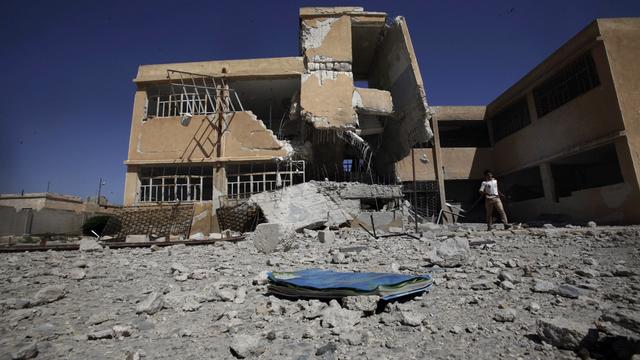 Une école détruite, près d'Alep. [Keystone]