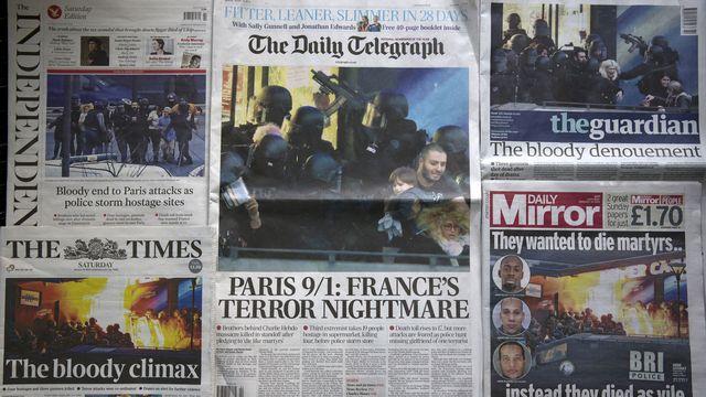 Des médias anglo-saxons comme le Guardian ont préféré ne pas rendre visible les dessins du magazine satirique français. [Justin Tallis - AFP]