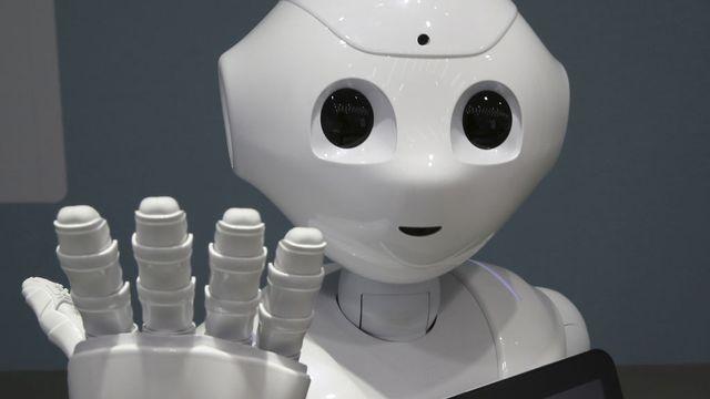 Dans le futur, quelle place prendront les robots dans notre quotidien? [Koji Sasahara - Keystone]