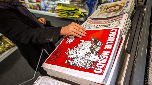 Le nouveau Charlie Hebdo sorti mercredi. [Philippe Huguen - AFP]
