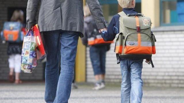 Les pères divorcés ont obtenu l'autorité parentale conjointe [Keystone]