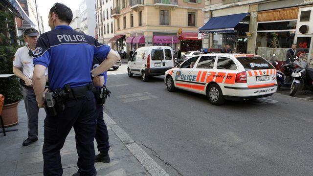Genève lance son premier test de vigilance citoyenne où chacun surveille son quartier en collaboration avec la police.  [Keystone]