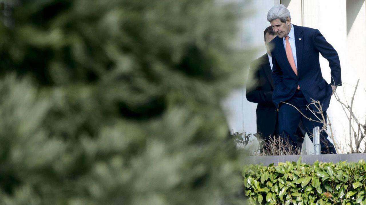 John Kerry dans les jardins du palace lausannois, le 19.03.2015. [Laurent Gilliéron - Keystone]