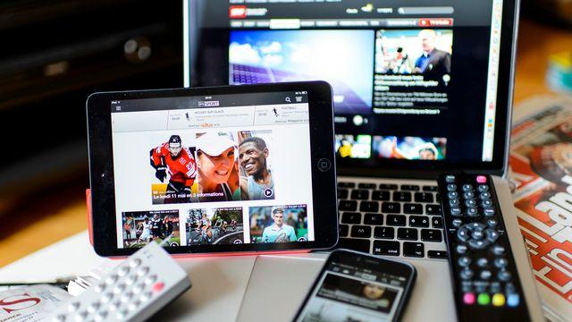 La généralisation de la redevance est liée à la multiplication des supports permettant d'écouter la radio et de regarder la télévision. [Jean-Christophe Bott - Keystone]