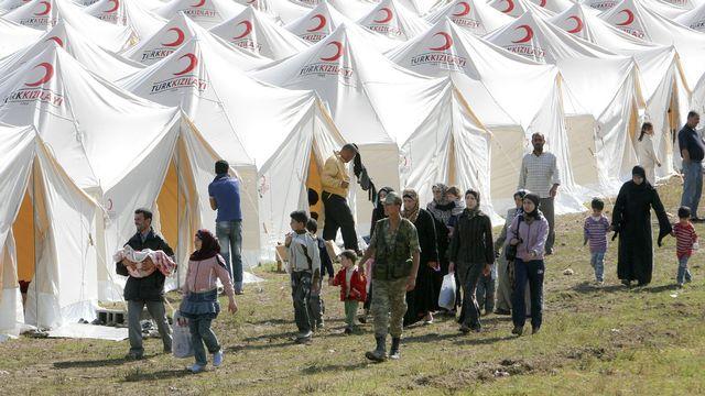"""Des """"repentis"""" du groupe EI ont rejoint des camps de réfugiés turcs à la frontière syrienne (ici, celui de Boynuyogun). [Selcan Hacaoglu - AP/Keystone]"""