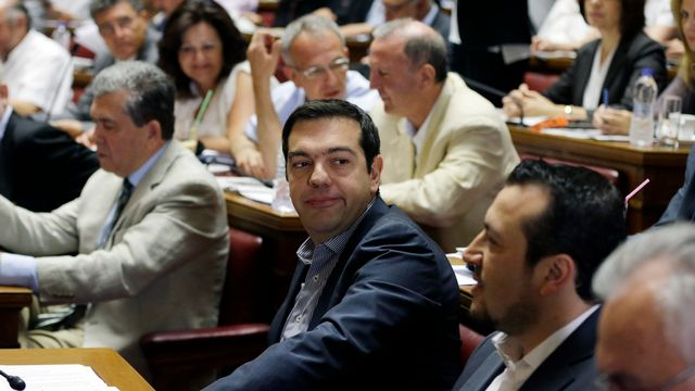 Alexis Tsipras au parlement grec. [Thanassis Stavrakis - AP/Keystone]